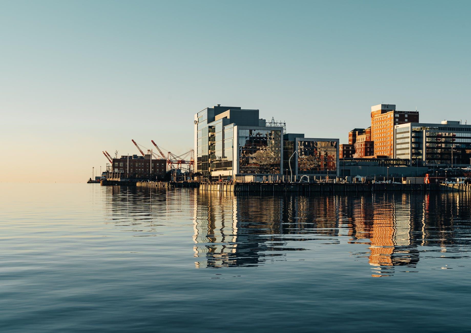 port on sea near buildings in city