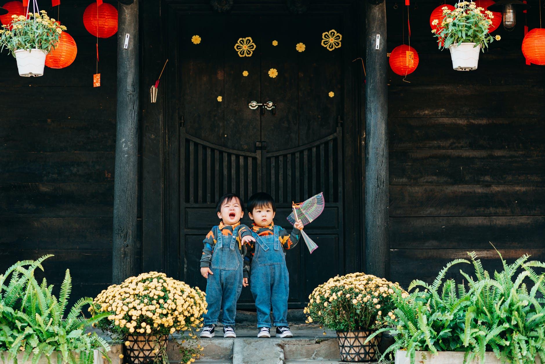 children wearing denim jumpers