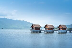 wooden houses on lake in summer day