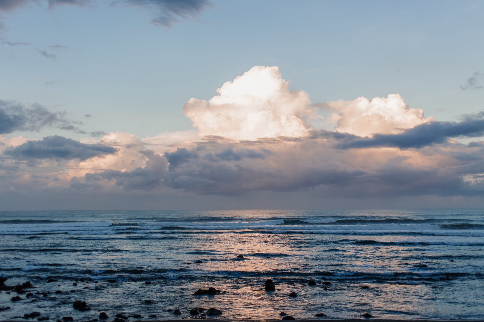 cumulus clouds over ocean