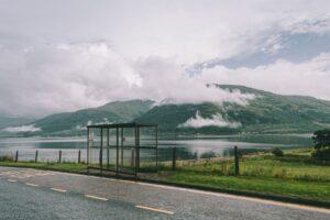 road near calm lake in countryside